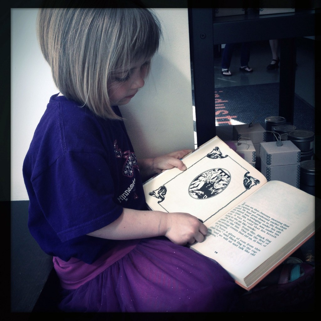 Stella reading Treasure Island